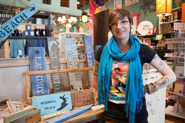Local artist Genna Boatright makes beach-themed signs from reclaimed wood. Photo by Chelsea Sektnan
