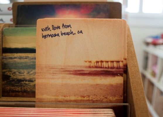 Wooden post cards made by a local artist feature the beach cities and sell well at local Hermosa Beach store Gumtree. Photo by Chelsea Sektnan