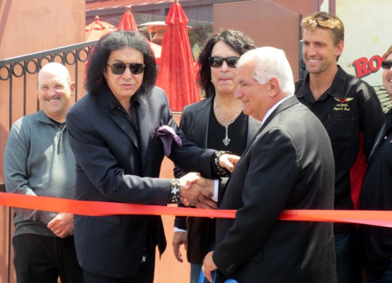 Gene Simmons shakes hands with Torrance Mayor Frank Scotto. Photo by Rachel Reeves