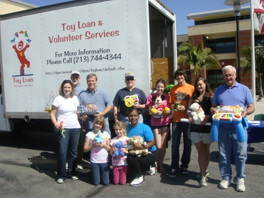 Volunteers at last year's toy drive. Courtesy of MB Kiwanis
