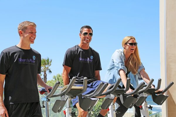 Olympic gold medalist volleyball player Eric Fonoimoana, Tour de Pier co-founder Heath Gregory and Olympic gold medalist volleyball player Kerri Walsh at a media event last month at the Strand House in Manhattan Beach.