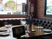 iPad technology enables guests to pour their own beer and swipe a credit card at the table. Photo by Rachel Reeves
