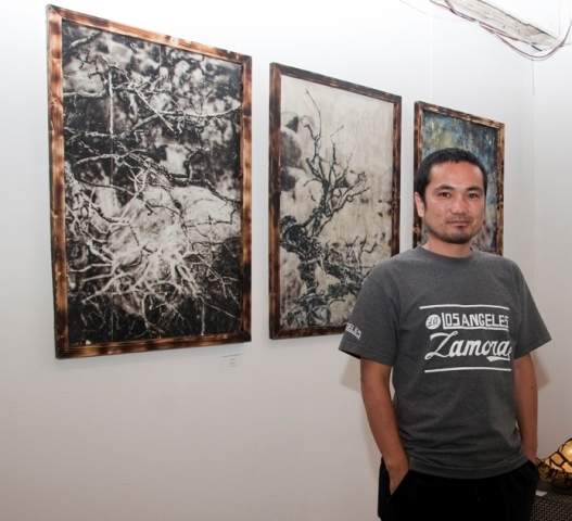 Artist Yoji Abe and his work at the opening reception last Saturday at Ego Fine Arts, 604 N. Francisca Ave., Redondo Beach. The work is up through June 30. (424) 206-3756. Photo by Gloria Plascencia