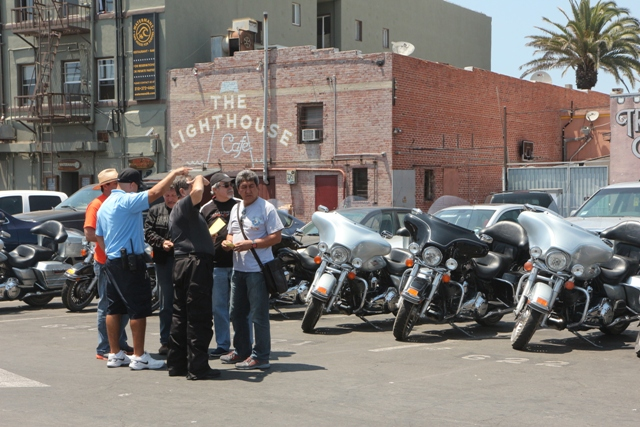 """Hermosa city staff explains parking violations to members of """"The Muppets"""" visiting from Ecuador. Photo by Ron Arias"""