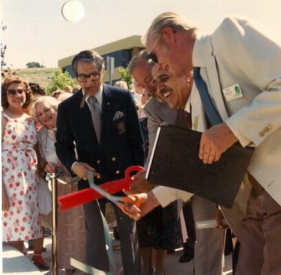 At the grand opening of the flower clock April 21, 1987, Michel Medawar cuts the ribbon as his friend actor Danny Thomas, Rolling Hills Estates Mayor Hugh Muller and developer Terry Cole look on.