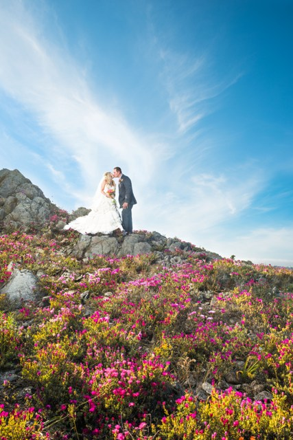 Danelle and Brent enjoy a quiet moment on a beautiful, poppy-covered hillside.