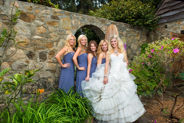 Danelle and bridesmaids  Casie Formiller, Jamie Romero, Gayla Moghannam and Heidi Wolf gather after the wedding in the stone walled garden of the 100-year-old Spindrift estate.
