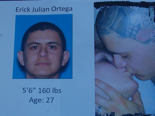 """Police are seeking the whereabouts of Erick Julian Ortega, the registered owner of the gunman's getaway car. His head is covered by a distinctive tattoo of the letters """"HA."""" Courtesy of RBPD"""