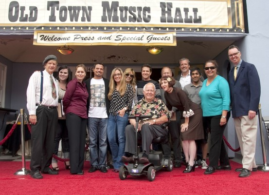 The Old Town Music Hall in El Segundo shows old time movies and hosts old time music shows, and we were recently invited out to meet some of the folks behind the scenes, who run the show as it were. L-r, Randy Woltz, Kimberly Lee, Tracey La Monica, Rich Botto, Amanda Toney, Lara Scott, James Moll, Bill Field (seated; he plays the Mighty Wurlitzer), Janet Klein (performing with her Parlor Boys on Oct. 13), Wesley Philips, Robert Chambers Pullman, Joel Jimenez, Lily Craig, and Carl Sonny Leyland (performing August 4). Photo by Gloria Plascencia. (310) 322-2592 or go to OldTownMusicHall.org.