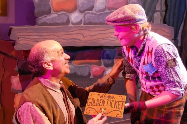 Gary Robbins is Grandpa Joe, and Logan Gould is Charlie Bucket.