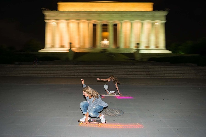 Cindy Whitehead skateboards past the Lincoln Memorial at night while in D.C. Photo by Ian Logan