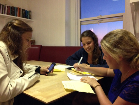Anna Blume, Nele Schmetterling and Anja Sonnenschein help Strobel translate the letters with a dictionary and online translation. Photo submitted by Stefanie Strobel