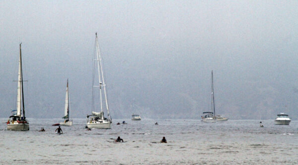 Paddlers venture into the fog from the isthmus on Santa Catalina Island. Photo by Gus McConnell
