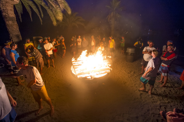 A bonfire illuminates the beach before the race begins. Photo by Ken Pagliaro