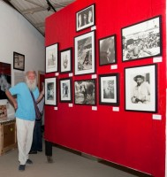 """Photographer Richard Abbott with his work at last Saturday's opening of """"Fab Four"""" at Ego Fine Arts, 604 N. Francisca Ave., Redondo Beach. The group show continues through Oct. 6. Photo by Gloria Plascencia. (424) 206-3756"""