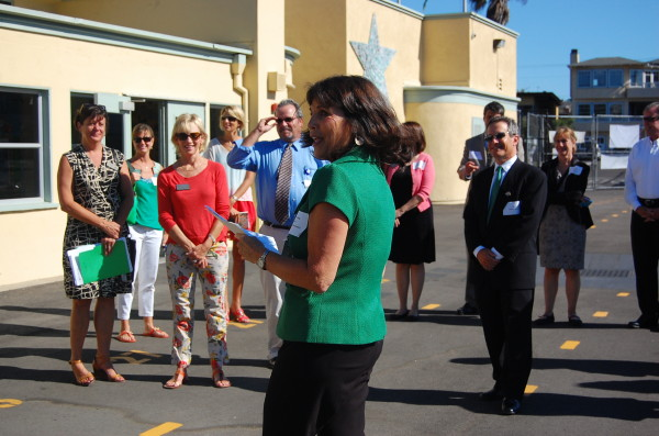 Grand View Elementary principal Rhonda Steinberg leads the group on a tour through campus.