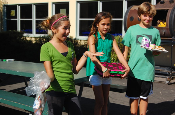 Grand View fifth graders Olivia Arensdorf, Sarah Fong and Colin Tournat illustrate how to pack a trash-free lunch and post-meal trash sorting.
