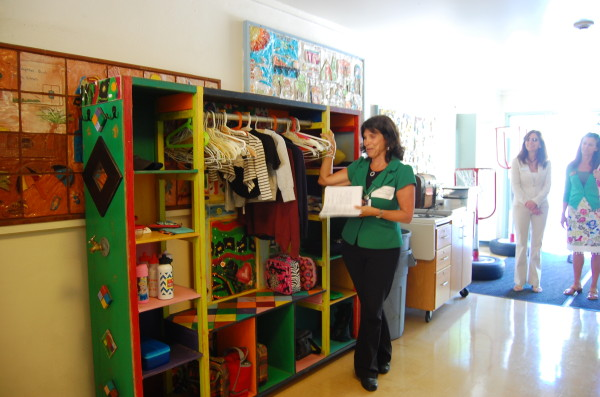 Inside the school, Principal Rhonda Steinberg shows a lost-and-found closet built by a parent. Every three months, unclaimed items are recycled into Good Will.