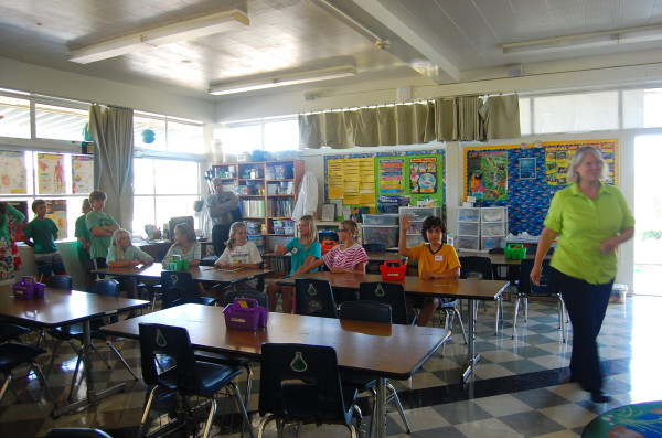 Members of Grand View's Earth Club, which includes 40 fifth graders, discuss lunch time recycling.