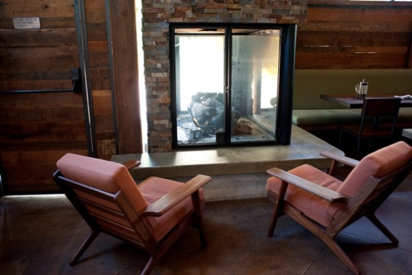 With windows on all four sides, the landmark fireplace creates a cozy corner without losing natural light.