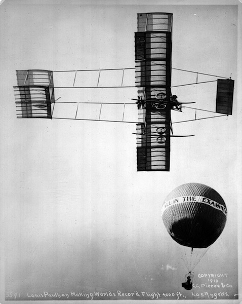 French aviator Louis Paulhan makes a record-breaking flight to 4,600 feet at the Los Angeles Air Meet in 1910. © The Huntington Library, Art Collections, and Botanical Gardens