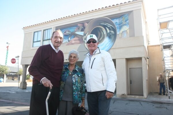 Gloria Cadena with former Lighthouse owner Howard Rumsey (left) and current Lighthouse owner Paul Hennessey (right) at last year's jazz mural unveiling.