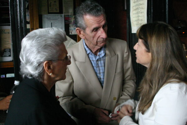 Gloria and Ozzie greet trumpet great Shorty Rogers' daughter at a 2006 Lighthouse jazz documentary premiere.