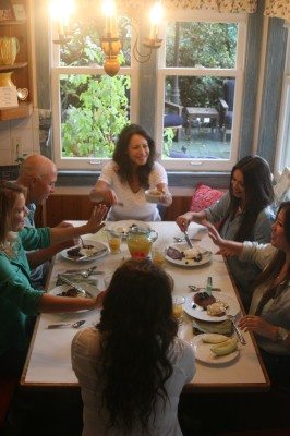 The Curry family enjoying pancakes and fruit at the breakfast table.