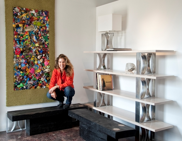 Blair Townsend with two of her creations, a toy rug and a bookcase. Photo by Gloria Plascencia