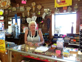 Longtime employee Rosemarie Dorin behind the counter at Shark Attack on the Redondo Pier. Photo