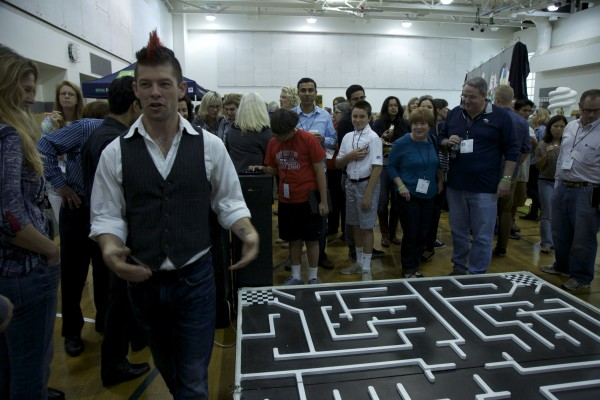 During the first break, 2-Bit Circus cofounder Eric Gradman busily strides through the STEAM Carnival corner of the gymnasium, where attendees could navigate wireless toy cars through a maze with an iPhone app.