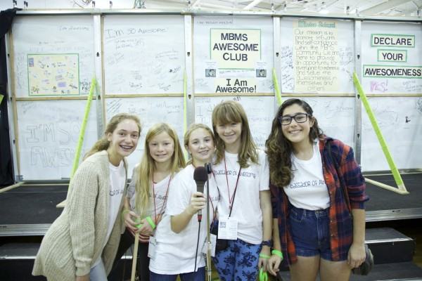 """The Manhattan Beach Middle School's Awesome Club, led by Mira Costa freshman Sara Reynolds (far left), encourage every attendee to """"declare your awesomeness"""" inside the exhibition hall."""