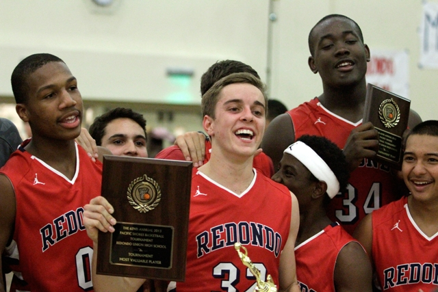 Redondo Union's Ian Fox, flanked by Ryse Williams (0) and Terrell Carter (34), celebrates winning the Pacific Shores championship and tournament MVP. Photo by Ray Vidal