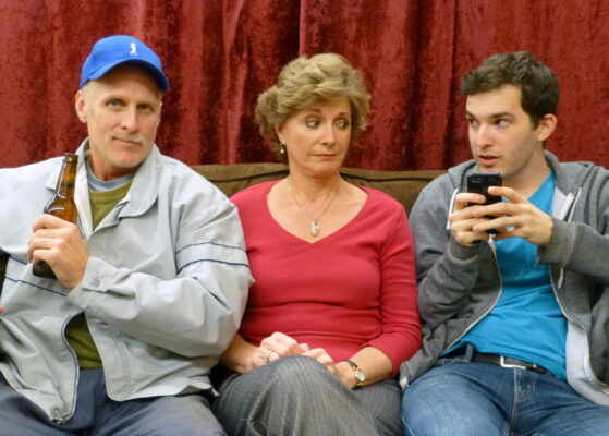 """Texting? It's a good thing that little son of a gun isn't behind the wheel! """"Becky's New Car"""" opens tomorrow (Friday) at the Westchester Playhouse, 8301 Hindry Ave., Westchester. Steven Dietz wrote it, and Susan Stangl is directing. Performances are Friday and Saturday at 8, with Sunday matinees at 2 p.m. Tickets, $18, less $2 for seniors, students, servicemen. Closes Feb. 15. Pictured, l-r, Bob Grochau, Cherry Norris, and Jaymie Bellous. Photo by Shari Barrett. (310) 645-5156 or go to kentwoodplayers.org"""