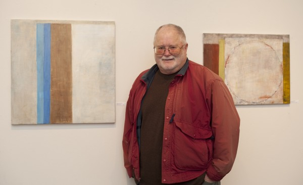 """Craig Antrim, with """"Sonata 14,"""" left, and """"Sonata 9,"""" right, is among the artists featured in """"Peace Be With You,"""" on view through January 25 at The Loft, 401 S. Mesa St., third fl., San Pedro. Photo by Gloria Plascencia. (310) 831-5757 or go to sanpedroartloft.com"""