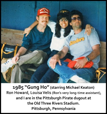 """During the filming of """"Gung Ho"""" (1985; starring Michael Keaton). Pictured, director Ron Howard, his long-time assistant Louisa Velis, and Steve Levine, in the Pittsburgh Pirates dugout at Three Rivers Stadium in Pittsburgh, PA"""