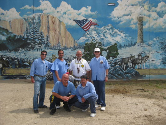 Veterans Embracing Truth (left to right, standing) B. Mentzer, J. King,  McCarter (Kinking Horse), C. Coley and (kneeling) left R. Fontes and R. Tarazon. Photos by Chris Lynch