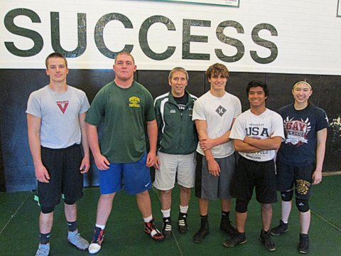 Mira Costa's wrestling team has enjoyed success behind strong performances by (left to right) Miles Gilliam, Jimmy Millea, Coach Jimmy Chaney, Jake Shapiro, Kit Murphy and Ariel Floro. Photo by Carmela Floro