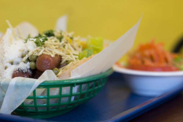 The cachorro quente, or hot dog, at Panela's Brazilian, is indicative of the creativity at work at the little restaurant tucked away in a residential Redondo Beach neighborhood. It features tomato, lettuce, corn, peas, parmesan cheese, potato strings, and parsley. Photo by Brad Jacobson
