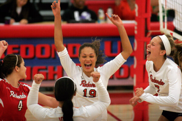 Briana Lanktree (center) celebrates with teammates  Katie Rotondo, Norene Losia and Abril Bustamante after Redondo defeated Corona del Mar to reach the 2012 CIF Division 1AA championship match. Photo by Ray Vidal