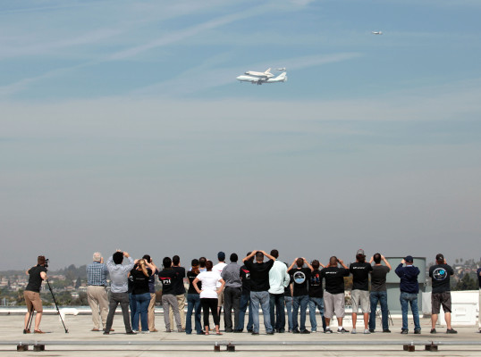SpaceX employees watch as Endeavor passes over their Hawthorne headquarters. The company recently won a contract to develop a successor to the space shuttle, which could be operational as early as 2015. Photo property of SpaceX