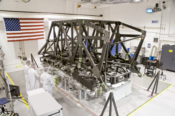 Technicians complete the center section of the backplane and backplane support frame for NASA's James Webb Space Telescope -- the successor to the Hubble Space Telescope. The frame will undergo structural static testing at Northrop Grumman's Redondo Beach facility this year before it launches in 2018. Photo property of ATK