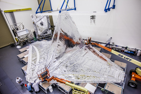 Technicians at Northrop Grumman's Space Park facilities in Redondo Beach conduct tests to ensure the Webb Telescope's sunshield membrane layers meet flight performance requirements. Photo property of Northrop Grumman