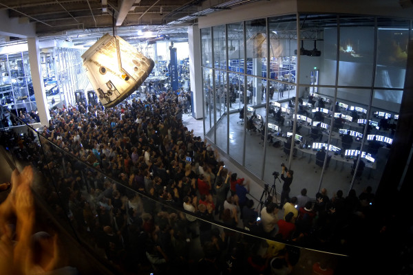 SpaceX employees watch the Falcon 9 SES-8 launch on a TV screen at the company's Hawthorne headquarters. Photo property of SpaceX