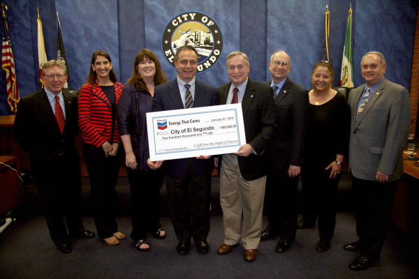 The City Council accepted a $200,000 check earmarked for economic development at Tuesday night's meeting. From left, Chevron's Rod Spackman, Councilwomen Marie Fellhauer and Suzanne Fuentes, Chevron's Frank Semancik, Mayor Bill Fisher, Councilman Carl Jacobson, Chevron's Lily Craig, and Councilman Dave Atkinson. Photo courtesy City of El Segundo