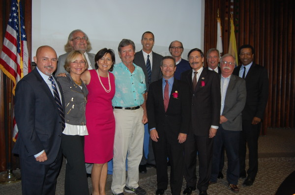 Newly inducted mayor Amy Howorth (third from left) is joined Dec. 17 in the Council Chambers by fellow councilmembers Tony D'Errico, David Lesser, Wayne Powell and Mark Burton as well as former Manhattan Beach mayors Portia Cohen, Russ Lesser, Bob Holmes, Steve Napolitano, Jim Aldinger, Tim Liligren and Mitch Ward. Photo by Esther Kang