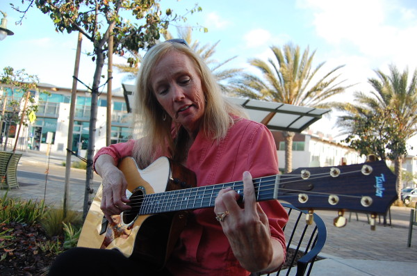 Marlene Hutchinson, 52, shows off her chops outside a cafe in Hermosa Beach. Photo by Esther Kang