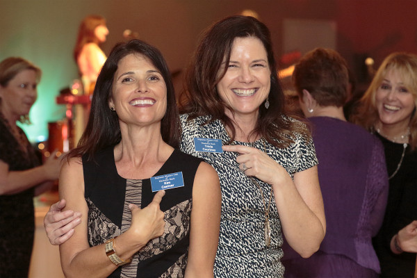 """Neptunian members Kim Castner and Tricia Courtney celebrate at Saturday's event, titled """"The Grand Fundraiser, Supporting 105 Years of Philanthropy and Community"""" at the Neptunian Clubhouse. Photo courtesy of Suzanne Sharer"""
