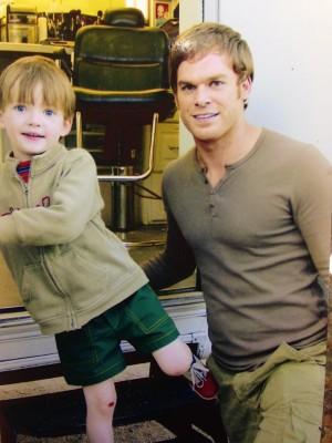 Maxwell Huckabee on the set of Dexter eight years ago with actor Michael C. Hall. Photo courtesy of Chris Canaday