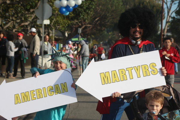 Kailani Melvin, an AMS second-grader, and her dad David finished the race and won the best costume contest as sign flippers.
